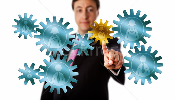 Consultant Picking A Worker Cog In A Gear Train Stock photo © leowolfert