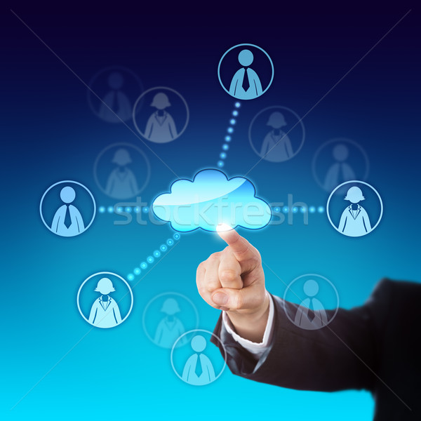 Contacting Office Workers Via The Cloud Stock photo © leowolfert
