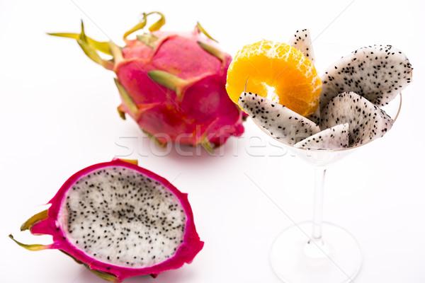 Vibrant purple fruit with white pulp - Pitaya Stock photo © leowolfert