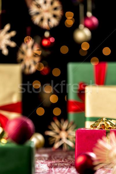 Xmas Presents under Baubles, Twinkles and Stars Stock photo © leowolfert