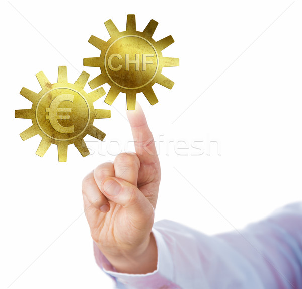 Swiss Franc And Euro Interlocking As Golden Cogs Stock photo © leowolfert