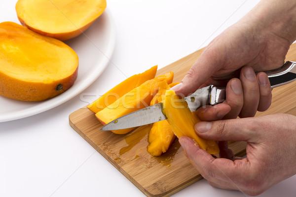 два рук сочный манго частей Сток-фото © leowolfert