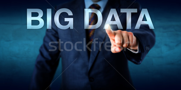 Manager Selecting BIG DATA On A Screen Stock photo © leowolfert
