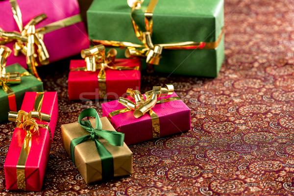 Seven Small Gifts on a Festive Blanket Stock photo © leowolfert