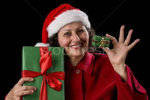 Smiling Old Woman Offering a Small and a Big Gift