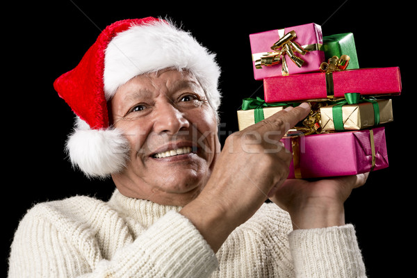 Male Senior Firmly Pointing At Six Wrapped Gifts Stock photo © leowolfert