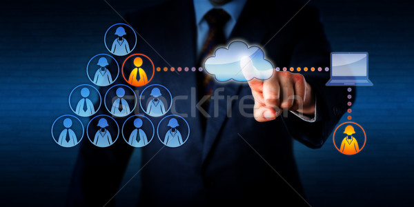 Manager Plugging-In A Remote Freelancer Via Cloud Stock photo © leowolfert