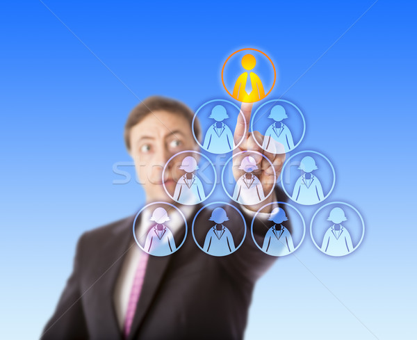 Manager Selecting A Male Worker Atop A Pyramid Stock photo © leowolfert