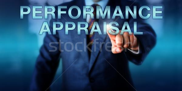 Gestionnaire toucher performances évaluation affaires Emploi Photo stock © leowolfert