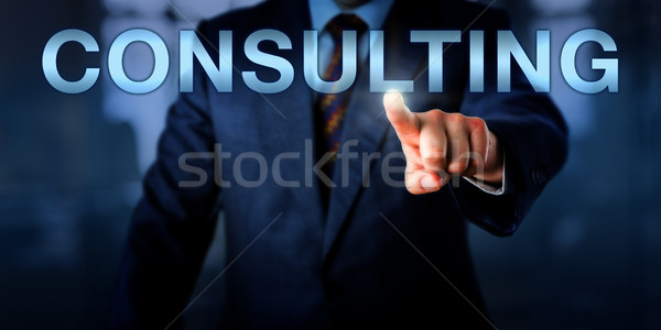 Management Consultant Pushing CONSULTING Onscreen Stock photo © leowolfert