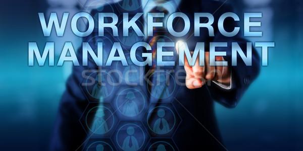 HR Manager Pushing WORKFORCE MANAGEMENT Stock photo © leowolfert