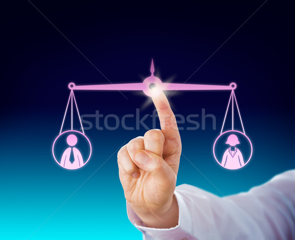 Keeping A Female And Male Worker Balanced By Touch Stock photo © leowolfert