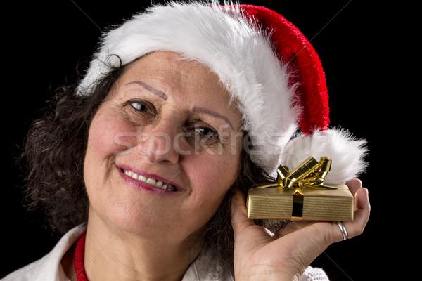 Middle-Aged Woman Holding Golden Gift Stock photo © leowolfert