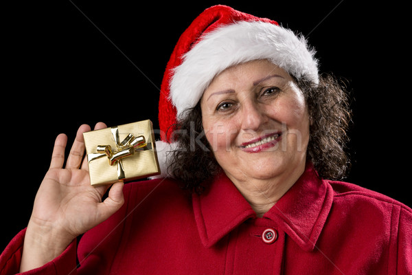 Smiling Old Lady Shows Golden Wrapped Christmas Gift Stock photo © leowolfert