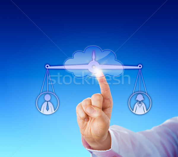Assessing A Female And A Male Worker In The Cloud Stock photo © leowolfert