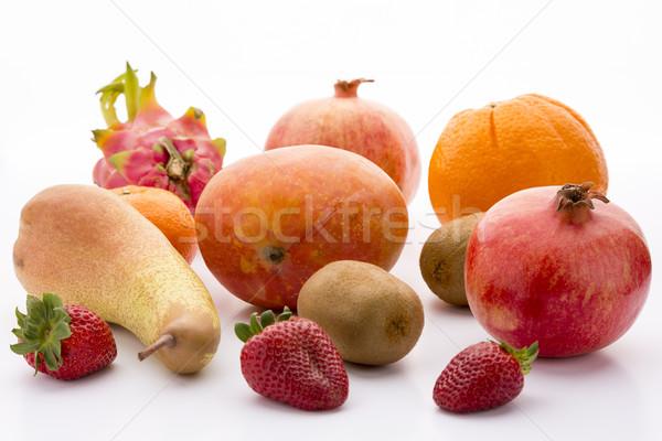 Mango, pomegranate, pitaya, orange, pear, kiwi and mandarine Stock photo © leowolfert