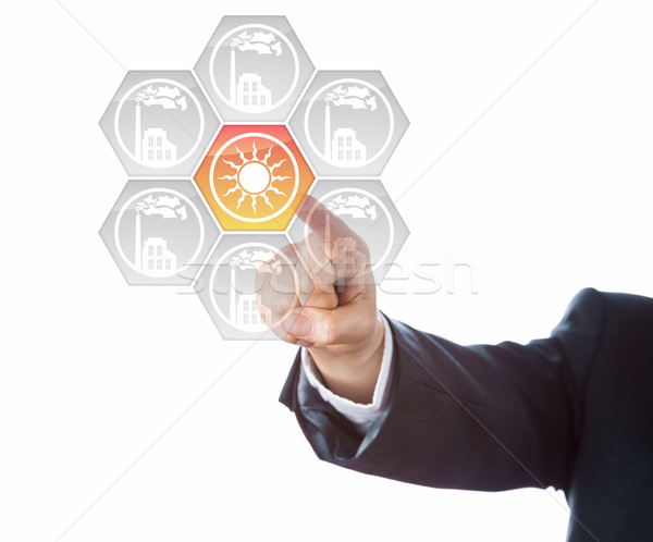 Arm In Blue Suit Pointing At Solar Energy Icon Stock photo © leowolfert