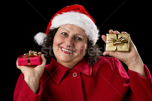 Elderly Lady with Wrapped Red and Golden Presents