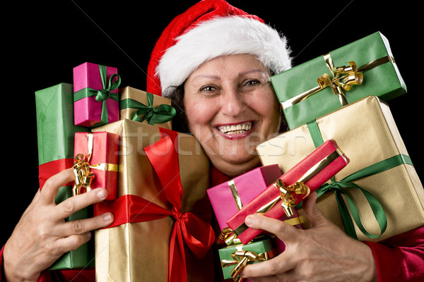 Cheerful Aged Woman Embracing Wrapped Presents 