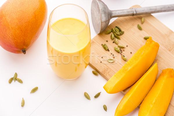 Glass Mango Lassie, Crushed Cardamon And Pestle Stock photo © leowolfert