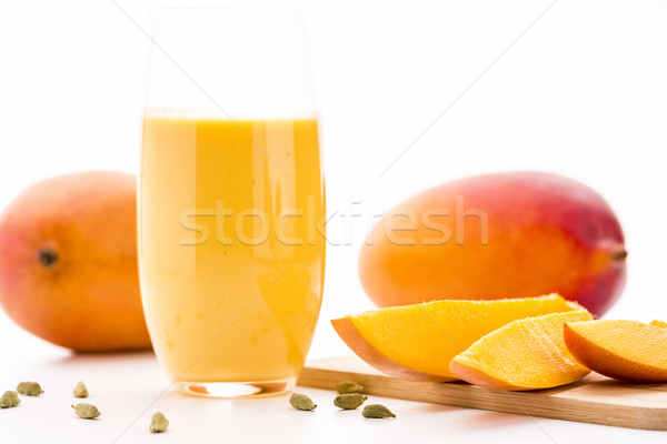 Cut Mango Pieces, Cardamon And Fruit Shake Stock photo © leowolfert
