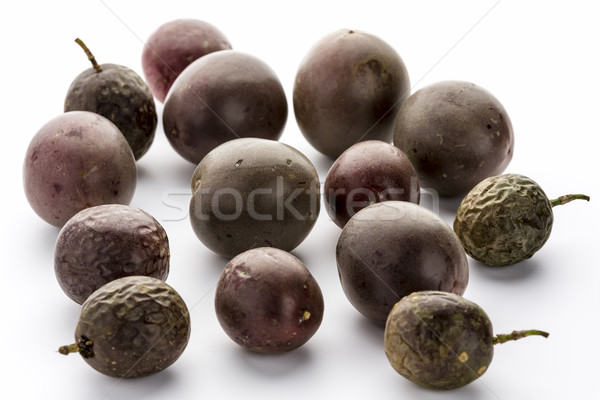 Fourteen Whole Purple Passion Fruits On White  Stock photo © leowolfert