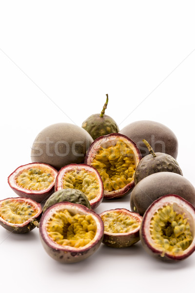 Sour Passion Fruit Pulp In Its Purple Rind Stock photo © leowolfert