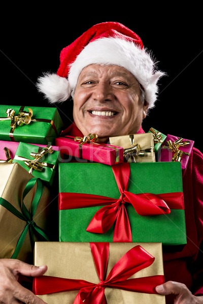 Merry Old Man With Broad Grin Loaded With Gifts Stock photo © leowolfert