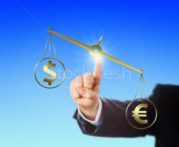 Euro Sign Outweighing The Dollar On A Balance Stock photo © leowolfert