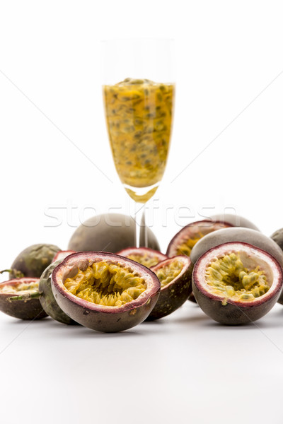 Halved Passionfruits And Fruit Pulp In A Glass Stock photo © leowolfert
