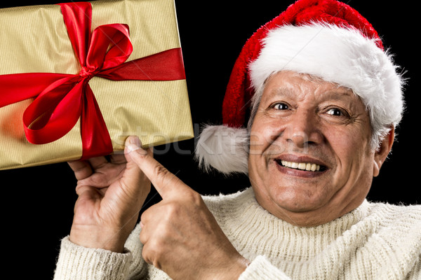 Excited Aged Man Pointing At Golden Gift In Hand Stock photo © leowolfert