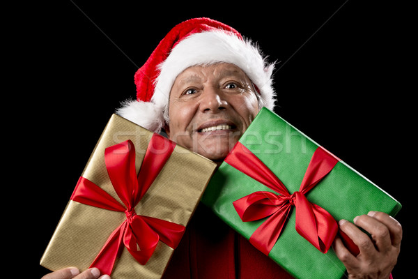 Old Man In Red Gaping Across Two Wrapped Gifts Stock photo © leowolfert