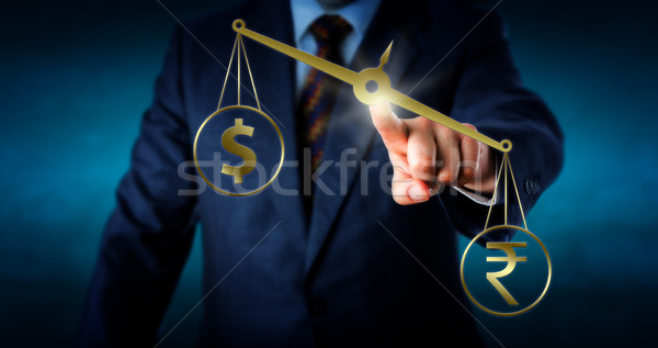Indian Rupee Outbalancing The US Dollar Stock photo © leowolfert