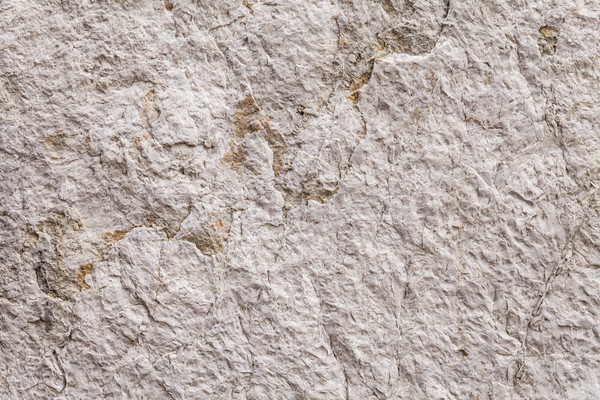 Close Up On Rough Texture Of An Ancient Stone Wall Stock photo © leowolfert