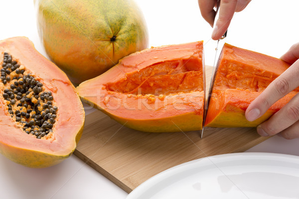First Cut Through A Hollowed Out Papaya Half Stock photo © leowolfert