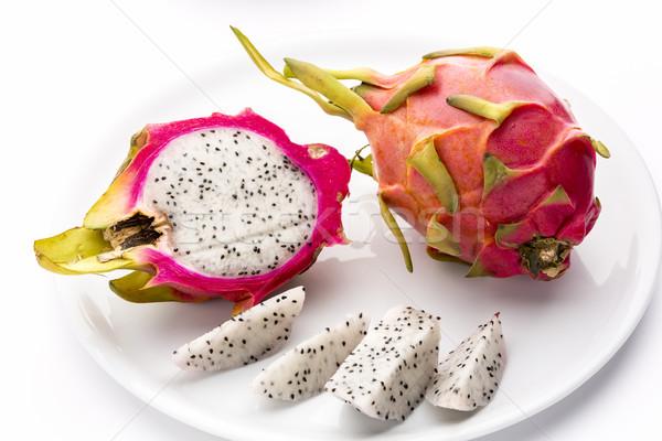 Pitaya, Whole, Halved And Cut Into Fruit Wedges Stock photo © leowolfert