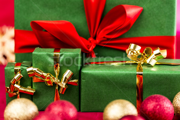 Four Xmas Presents with Bows in Gold and Red Stock photo © leowolfert