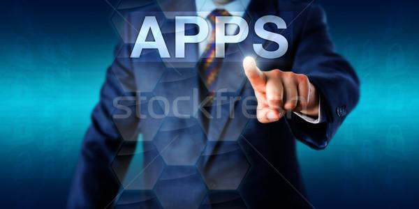Entrepreneur Touching The Word APPS In Cyberspace Stock photo © leowolfert