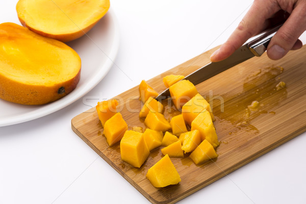 Ripe Mango Fruit Pulp Diced With A Kitchen Knife Stock photo © leowolfert