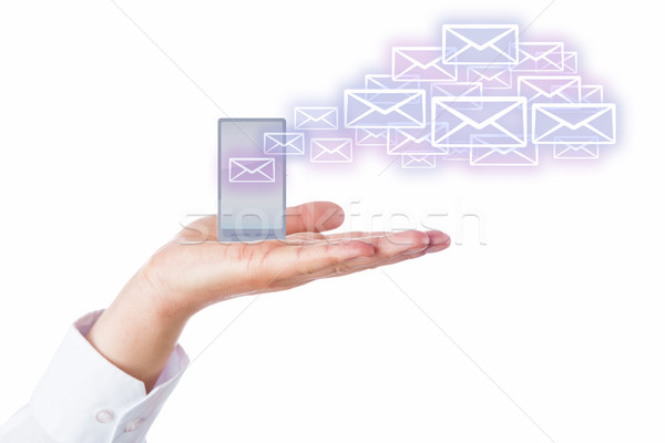 Emails Leaving Cell Phone In A Palm For The Cloud Stock photo © leowolfert