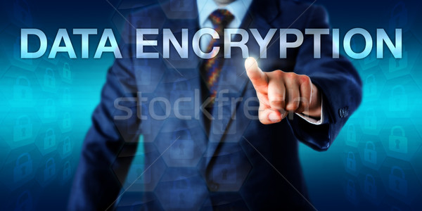 Manager Pushing DATA ENCRYPTION Onscreen Stock photo © leowolfert
