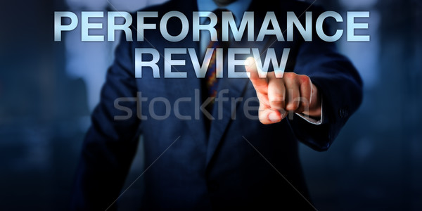 Manager Touching PERFORMANCE REVIEW Onscreen Stock photo © leowolfert