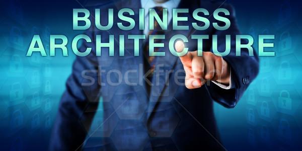 Executive Touching BUSINESS ARCHITECTURE Onscreen Stock photo © leowolfert