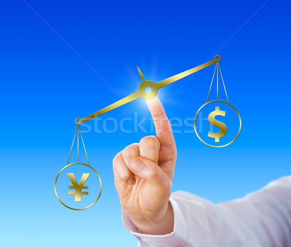 Yen Sign Outweighing The Dollar On A Golden Scale Stock photo © leowolfert
