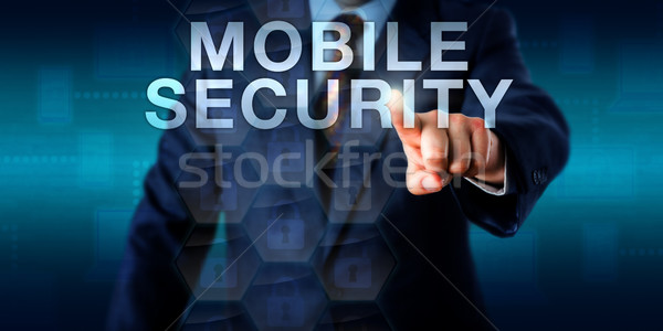 Supervisor Touching MOBILE SECURITY Onscreen Stock photo © leowolfert
