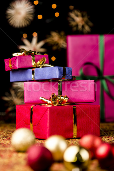 Gift Parcels Piled up amidst Baubles and Stars