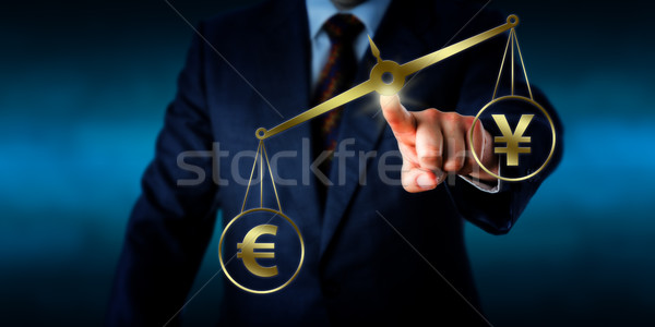 Euro Sign Outweighing The Yuan On A Golden Scale Stock photo © leowolfert