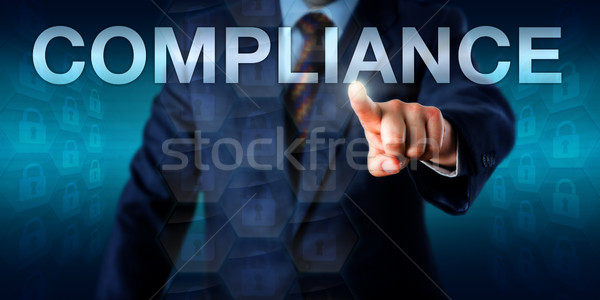 Manager Touching COMPLIANCE In Cyberspace Stock photo © leowolfert