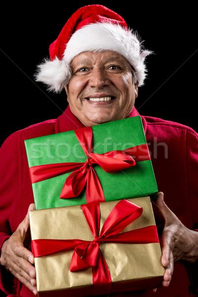 веселый мужчины пенсионер красный два подарки Сток-фото © leowolfert