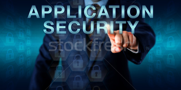 Executive Pushing APPLICATION SECURITY Onscreen Stock photo © leowolfert